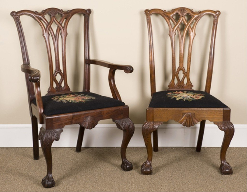 11: Group of four Chippendale style chairs.