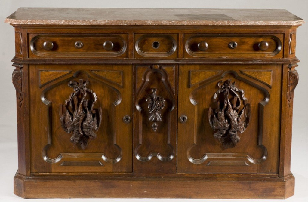 15: American carved walnut hunt sideboard.