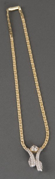 78: 14KT gold necklace with clear stones