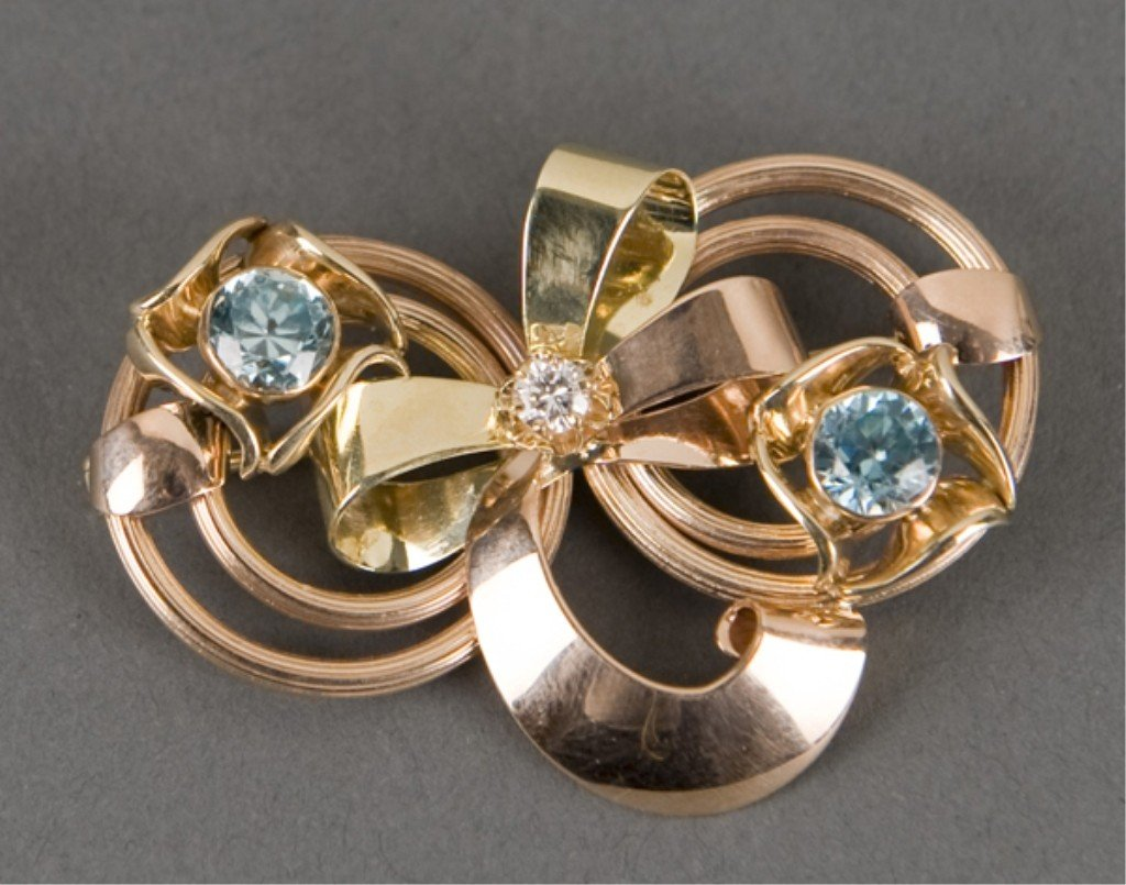 83: Vintage gold, diamond and zircon brooch