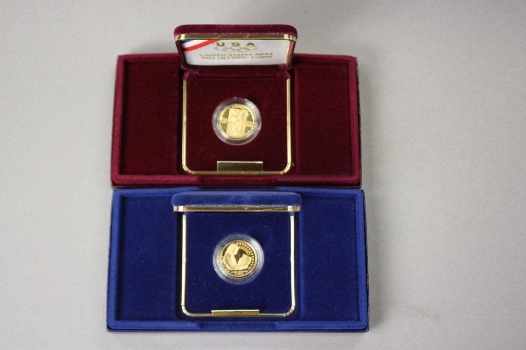 309: 2 commemorative gold coins -