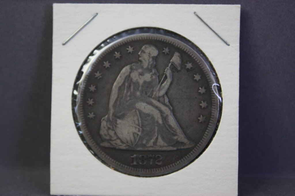313: 1872 Seated Liberty silver dollar.