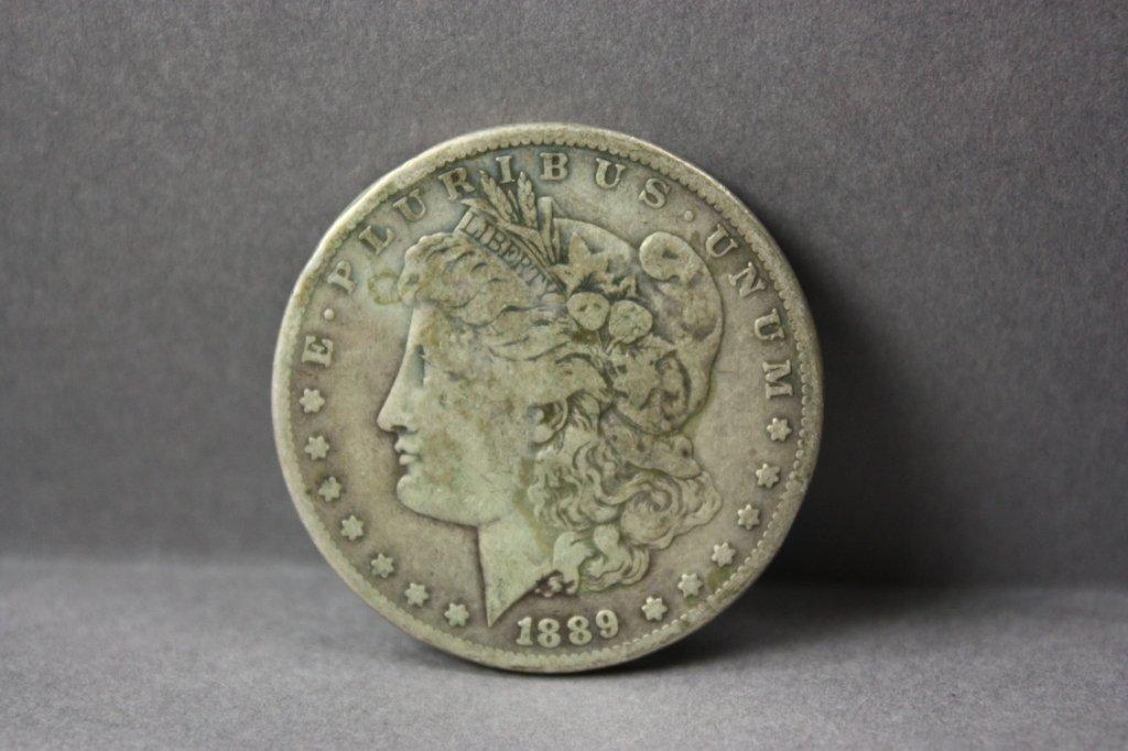 314: 1889-CC Morgan silver dollar.