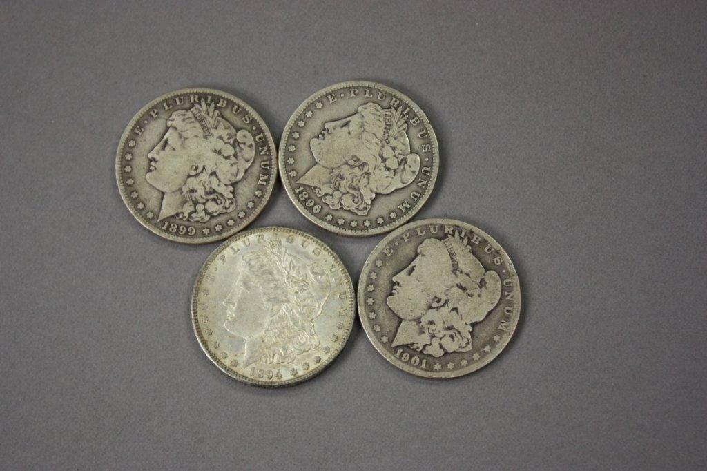 316: Lot of 4 Morgan silver dollars -