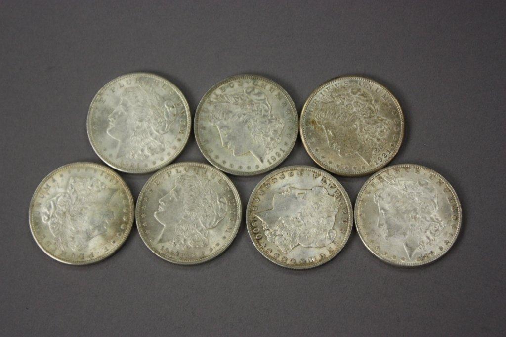318: Lot of 7 Morgan silver dollars -