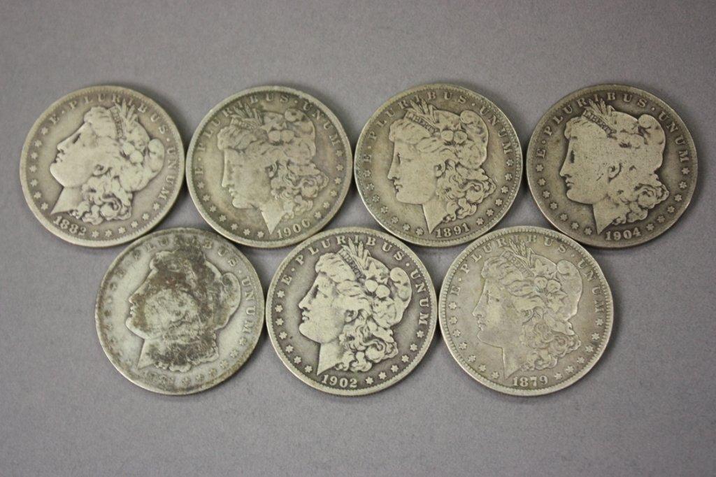 319: Group of 7 Morgan silver dollars -