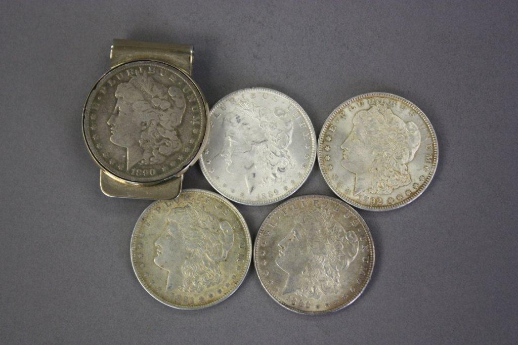 320: 5 Morgan silver dollars.