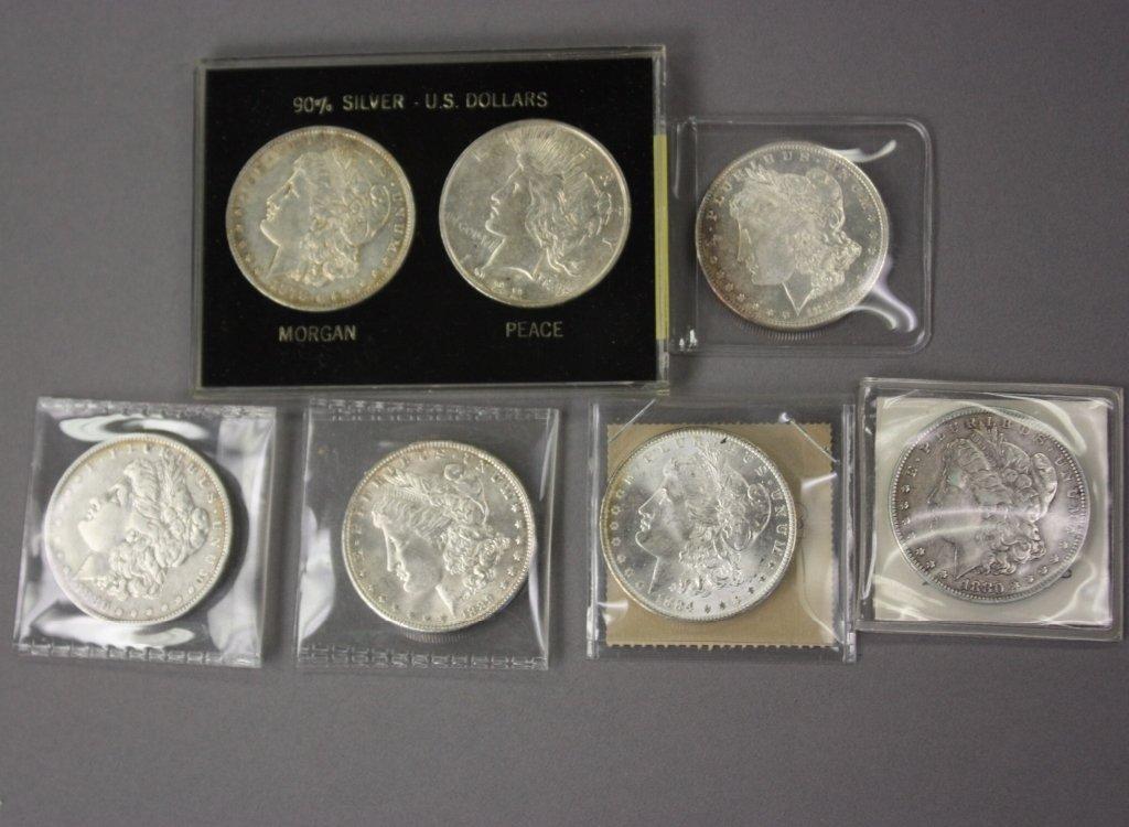 321: 6 morgan silver dollars and 1 peace dollar.