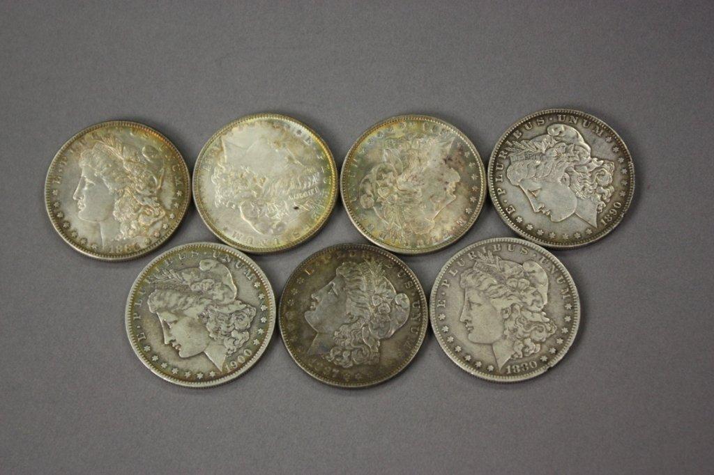 322: 7 Morgan silver dollars.