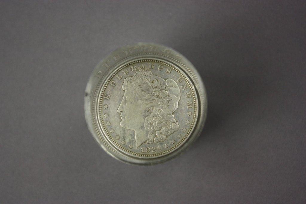 324: Eleven 1921 Morgan silver dollars.