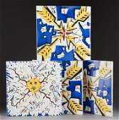 264: Four Salvador Dali ceramic tiles, signed.