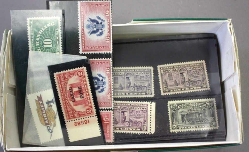 Checkbook box of loose U.S. stamps