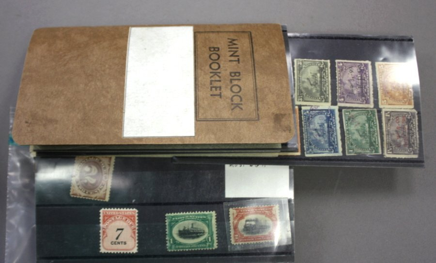 Ziplock bag of loose U.S. stamps in display cards,