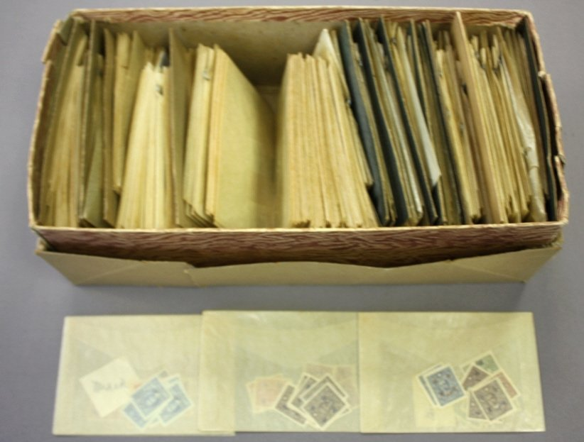 Shoe box of Mostly Chinese  loose stamps in