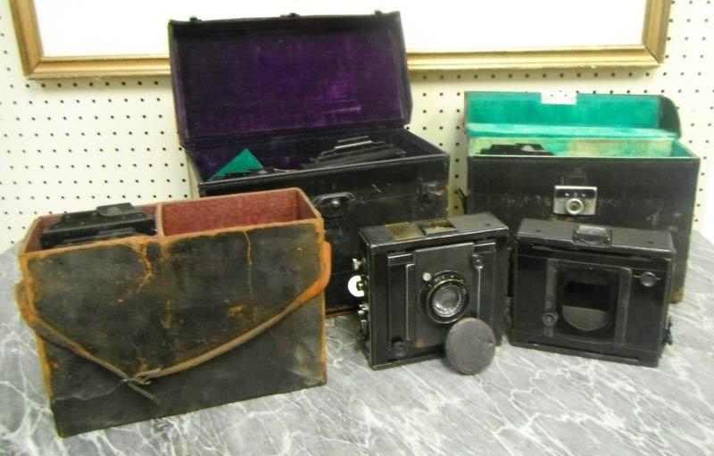 11: Group of 2 C. P. Goerz cameras & box of slides.