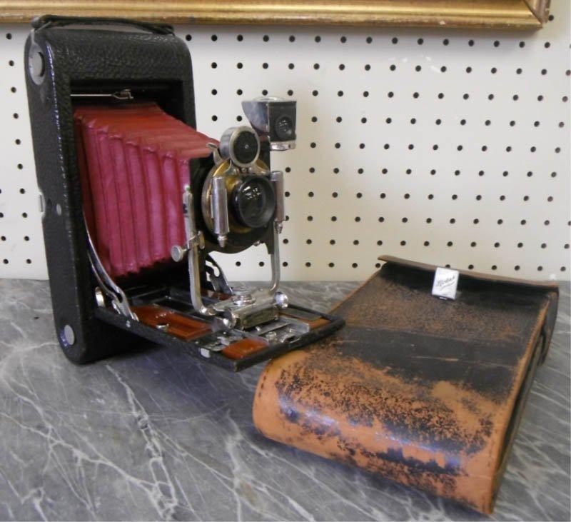 20: Eastman Kodak folding camera.