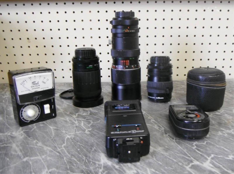 23: 3 screw mount Vivitar zoom lenses and accessories.