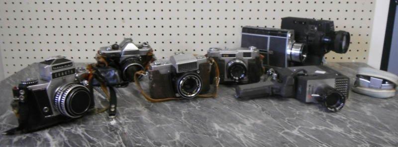 24: Group of 4 cameras and 3 film cameras.
