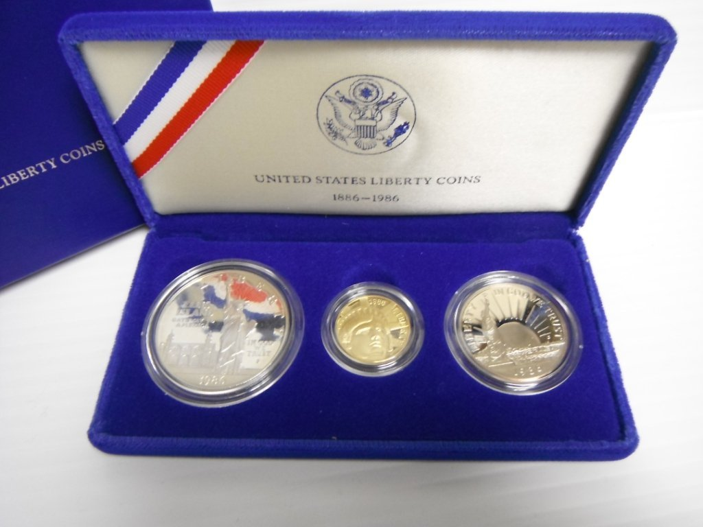 13: 1986 US Liberty coins set incl $5 gold coin.