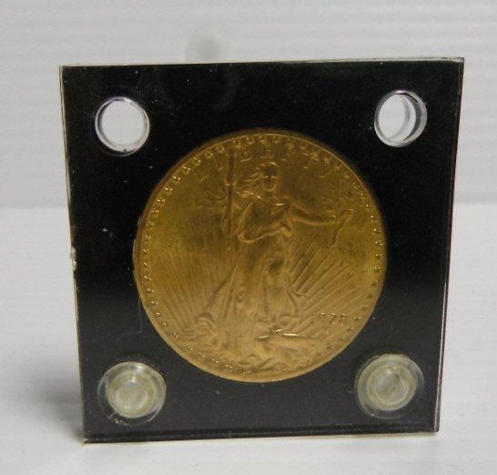 21: 1928 St Gaudens $20 gold coin BU.