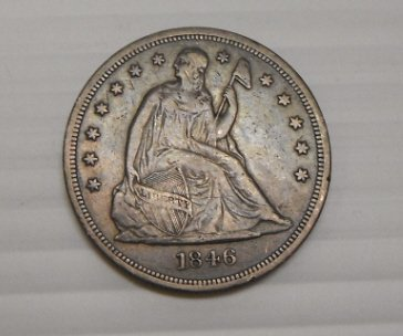 23: 1846-O Seated Liberty silver one dollar coin.