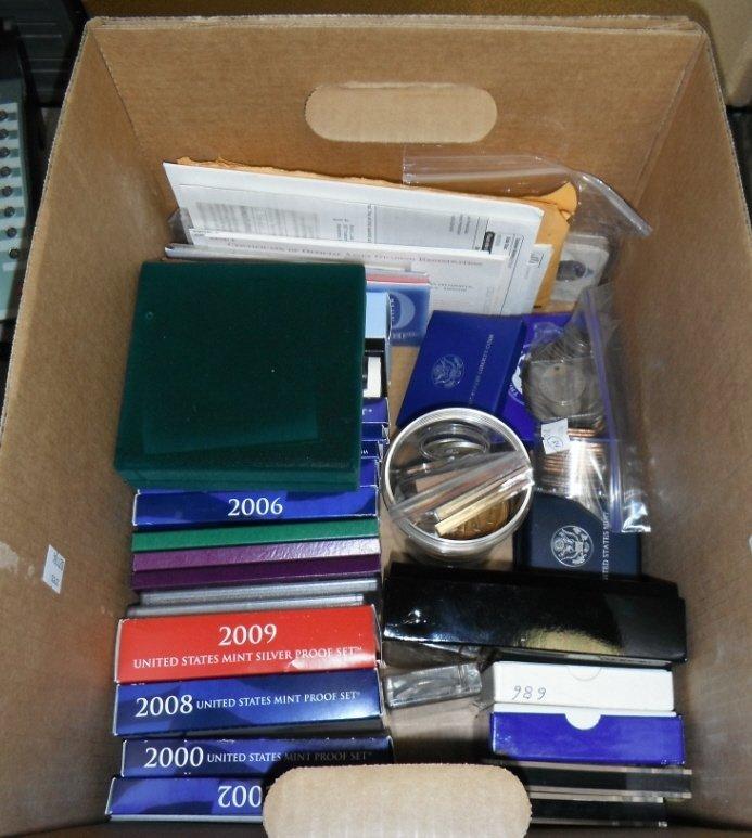 181: Box lot of US mint proof sets & various medals.