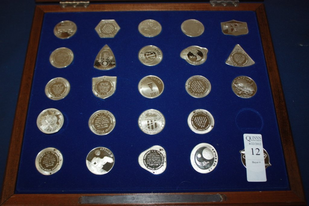 12: Case of 25 sterling silver NASA related medals.