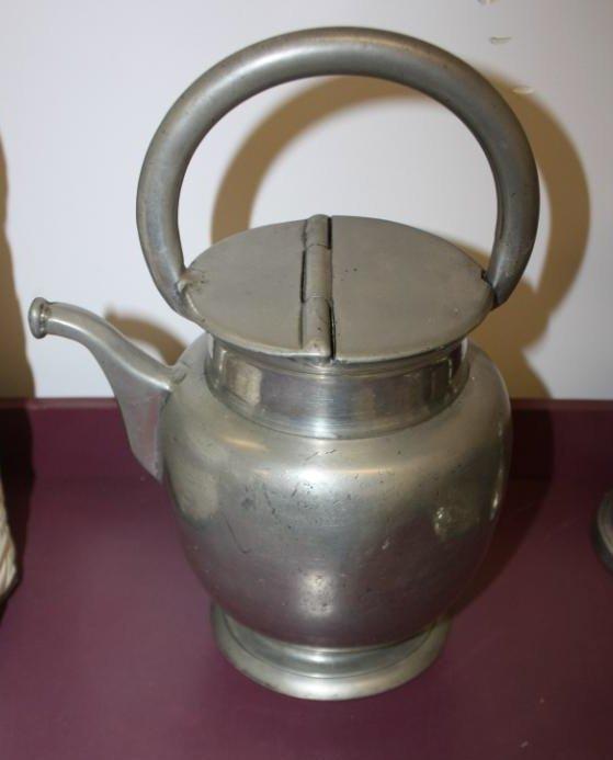 14: Pewter tea kettle.