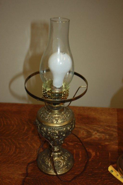 16: Ornate metal based table lamp.