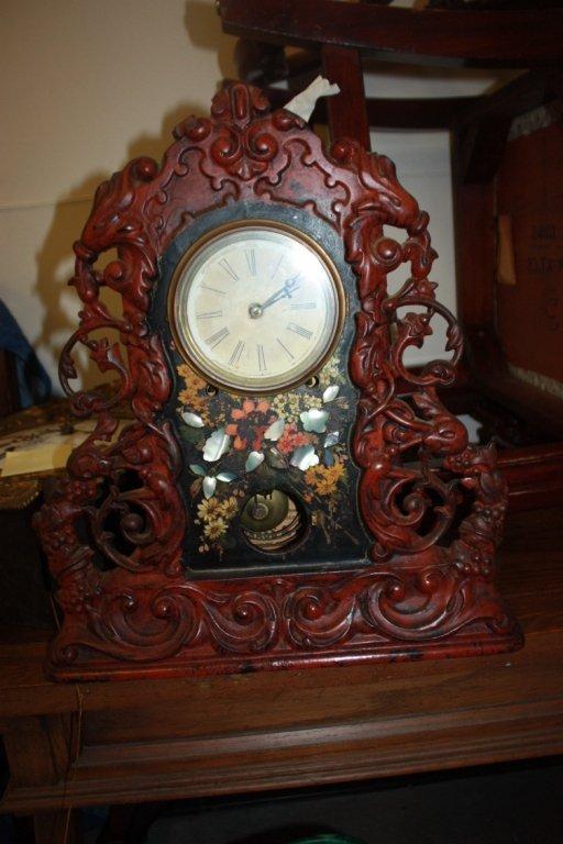 18: Antique cast iron framed kitchen clock.