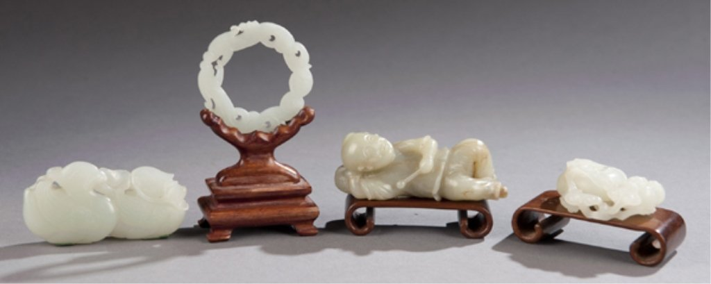 270A: Group of 4 carved jade pieces w/ wooden stands