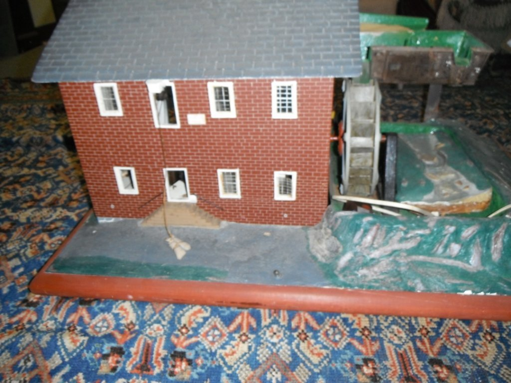 2004: House with electric elements and water wheel.