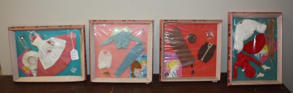 2010: Group of 4 Barbie outfits in original packaging