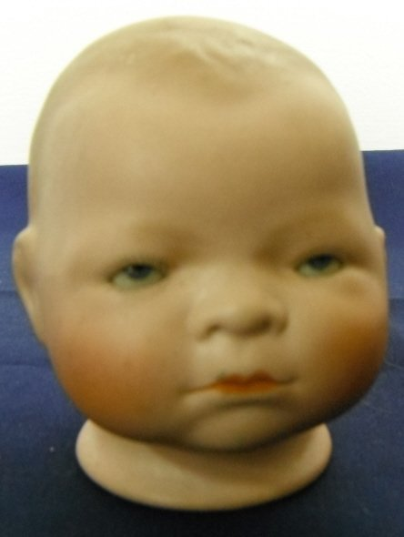 2011: Grace Putnam. Bisque Doll Head with Sleeper Eyes.