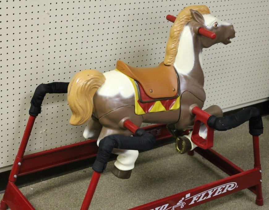 2125: Radio Flyer hobby horse on red stand.