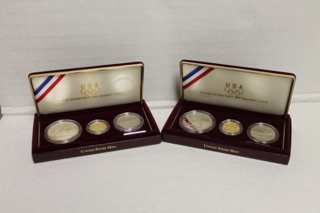 11: 2 1992 US Olympic coins three-coin proof set.