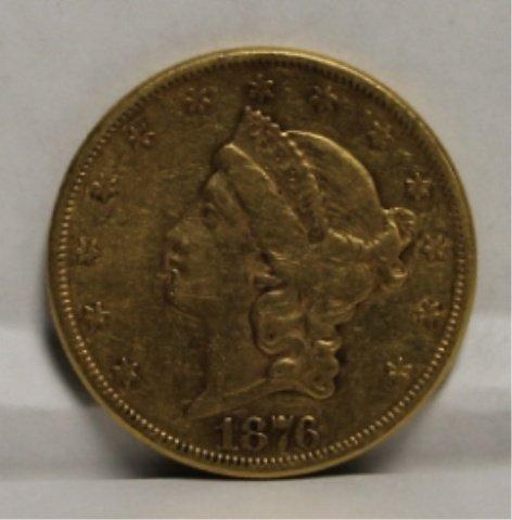 23: 1876 20 dollar Liberty Head gold coin.