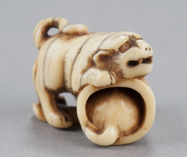 4: An ivory netsuke of tiger with cub.
