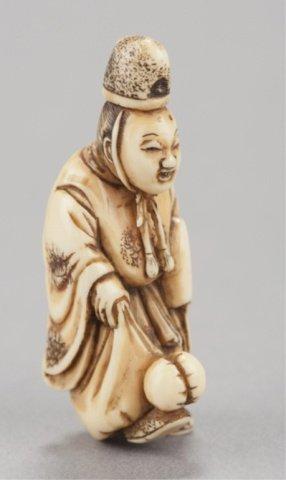 6: An ivory netsuke of a court noble.