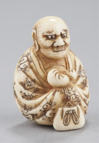 9: An ivory netsuke of Daruma.