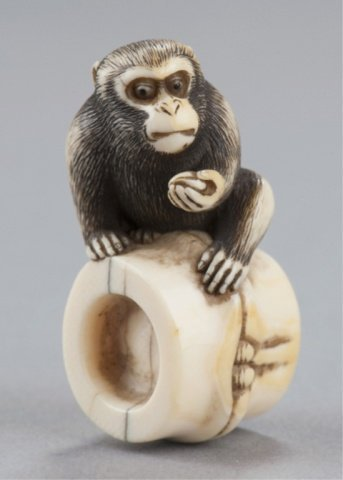 16: An ivory netsuke of a monkey.