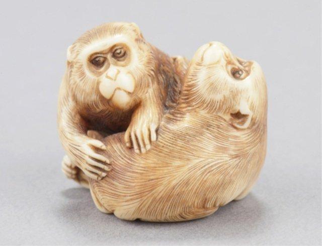 17: An ivory netsuke of two monkeys.