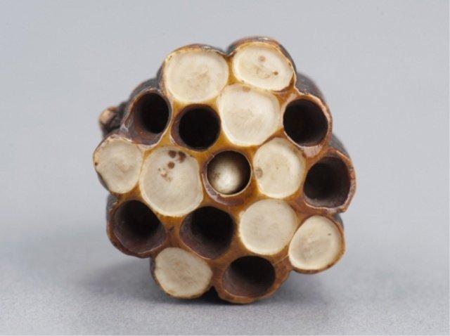22: An ivory netsuke of a wasp on its nest.