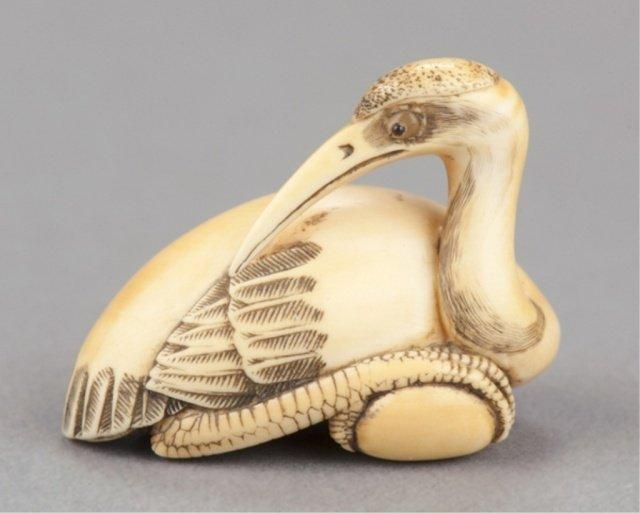 24: An ivory netsuke of a Manchurian crane