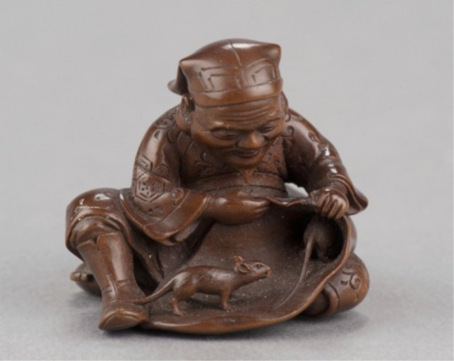 190: A wood netsuke of Daikoku and bag of rats