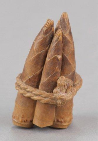 191: A wood netsuke of 5 bamboo shoots.
