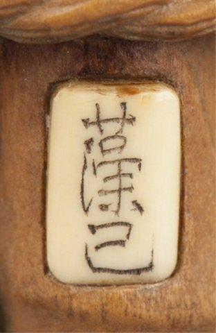 191: A wood netsuke of 5 bamboo shoots. - 6