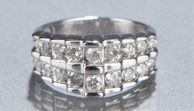 10: 10KT two row diamond ring.