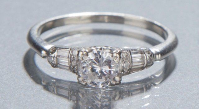 14: Diamond engagement ring.