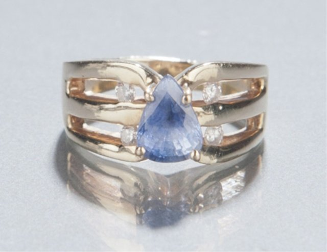 15: 14KT gold tanzanite and diamond ring.